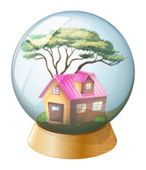 A crystal ball with a pink house inside