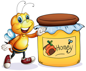 A bee beside the jar of honey