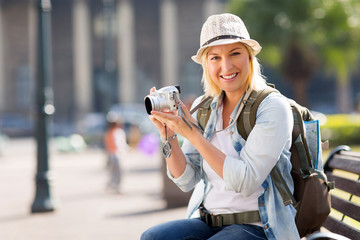 female tourist holding a camera
