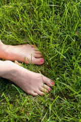 Foot over green grass.