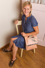 Smiling Blonde Woman With Pink Purse