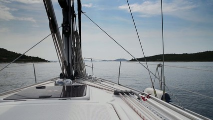 Yacht sailing in Croatia, calm sea with cloudy sky