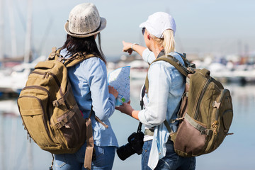 two female tourists by the harbor