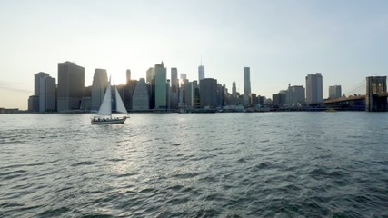 View of Manhattan with water and sailboat