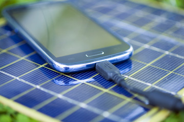 Charging smart-phone with solar charger
