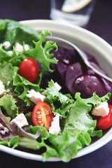 Fresh green salad with beetroot slices and feta