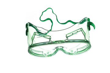 Green goggles with strap on white background