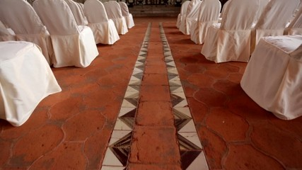 Pan up of a walk down an aisle at non denominational place