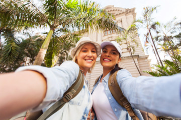 two female travellers taking selfie together