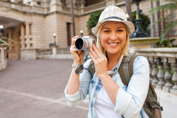 tourist with camera in front of historical building