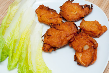 Pakora on white plate close up