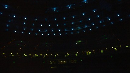 View of microphone from the stage.  Blue and green spotlights