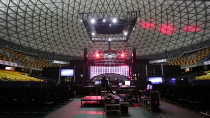 Tilt up of  lighting test at stage in venue  before concert