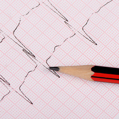 The tape with the cardiogram of a man