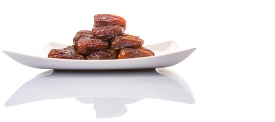 Date fruits on a white plate