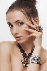 beautiful woman in jewelry with perfect skin