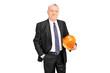Mature businessman holding a protective helmet