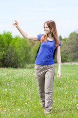 Girl walking on a meadow