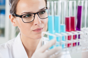 Woman looking at test tubes