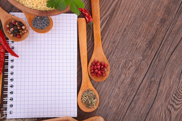 notebook with spices and herbs