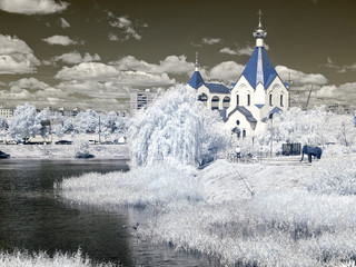 Church ashore lake. Temple of All Saints in earth Russian. Infra