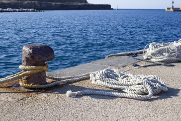 bollard and rope in harbor