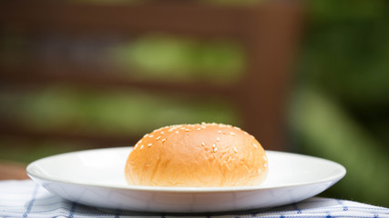 bread with sesame seeds on white plate