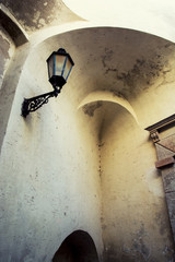 Arched wall with vintage lantern