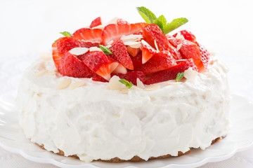 delicious cake with whipped cream and fresh strawberries