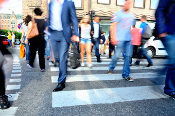 Motion blurred crowd crossing street