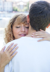 Woman in love embracing her boyfriend