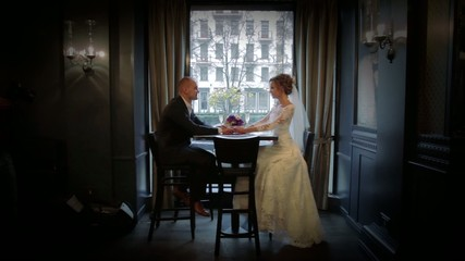 Wedding couple in a prestigious restaurant