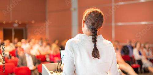 Leinwandbild Motiv Female academic professor lecturing at the faculty.