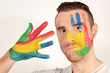 Young man with hand and face painted