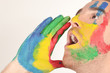 Young man screaming with hand painted face