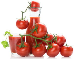 Bottle and glass of tomato juice and tomatoes
