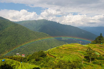 Rainbow over village in bhutan