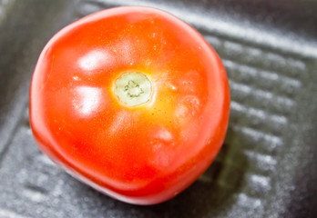 Tomato on a foam tray