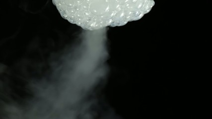 Bursting bubbles with a smoke.