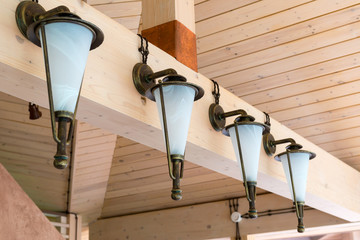 Retro lanterns mounted on a wooden interior