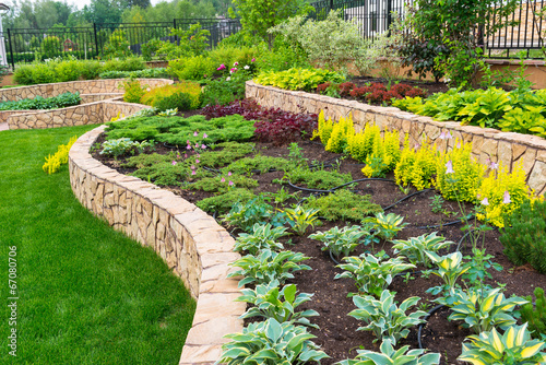 Natural landscaping in home garden - 67080706