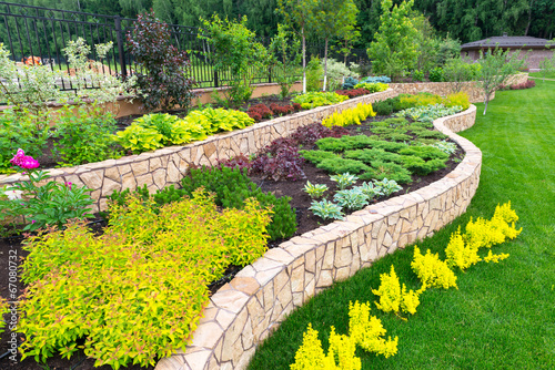 Natural landscaping in home garden - 67080732