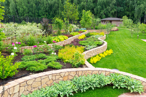 Natural landscaping in home garden - 67080749