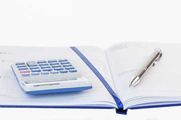 Calculator and Pen on a Diary
