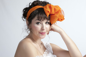 Woman with orange bow