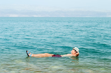 floating in water of dead sea