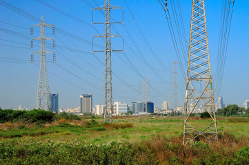 Industrial view with big electric pylons  in central israel