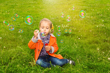 girl grass soap bubbles