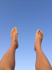 legs with blue sky background