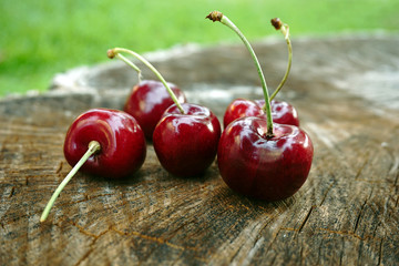fresh cherries on wooden background